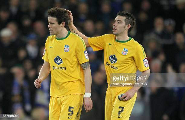 Crystal Palace's Patrick McCarthy is consoled by teammate Darren Ambrose after receiving the red card by referee Howard Webb for a second bookable...