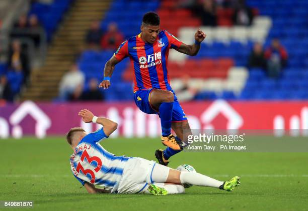Crystal Palace's Patrick van Aanholt is tackled by Huddersfield Town's Florent Hadergjonaj during the Carabao Cup third round match at Selhurst Park...