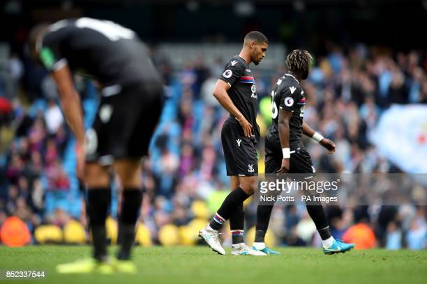 Crystal Palace's Ruben LoftusCheek and his teammates stand dejected after the Premier League match at the Etihad Stadium Manchester