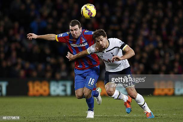 Crystal Palace's Scottish midfielder James McArthur vies Tottenham Hotspur's French midfielder Benjamin Stambouli during the English Premier League...