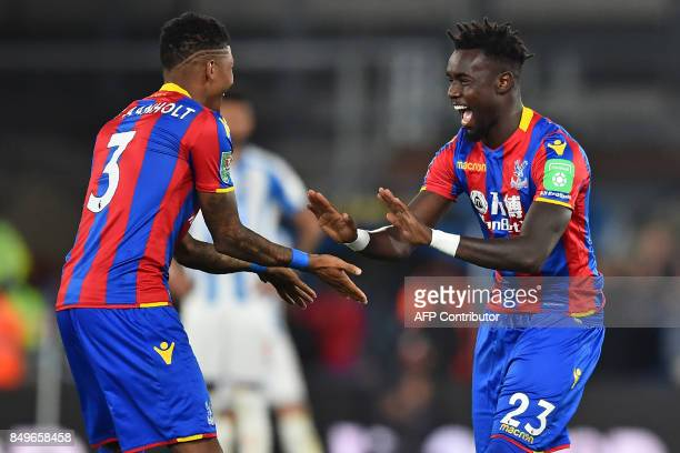 Crystal Palace's Senegalese defender Pape Souare gestures to Crystal Palace's Dutch defender Patrick van Aanholt as he starts the second half after...