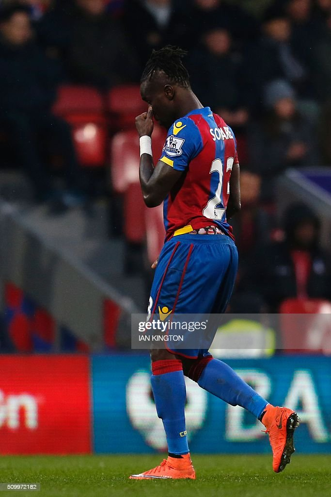 Crystal Palace's Senegalese defender Pape Souare leaves the pitch after getting a red card during the English Premier League football match between Crystal Palace and Watford at Selhurst Park in south London on February 13, 2016. / AFP / Ian Kington / RESTRICTED TO EDITORIAL USE. No use with unauthorized audio, video, data, fixture lists, club/league logos or 'live' services. Online in-match use limited to 75 images, no video emulation. No use in betting, games or single club/league/player publications. /