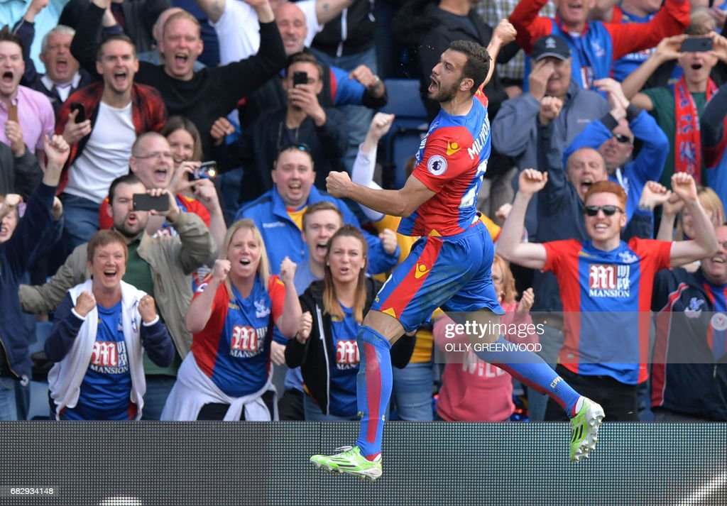 TOPSHOT - Crystal Palace's Serbian midfielder Luka Milivojevic celebrates scoring a goal off a penalty during the English Premier League football match between Crystal Palace and Hull City at Selhurst Park in south London on May 14, 2017 / AFP PHOTO / OLLY GREENWOOD / RESTRICTED TO EDITORIAL USE. No use with unauthorized audio, video, data, fixture lists, club/league logos or 'live' services. Online in-match use limited to 75 images, no video emulation. No use in betting, games or single club/league/player publications. /