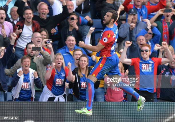 TOPSHOT Crystal Palace's Serbian midfielder Luka Milivojevic celebrates scoring a goal off a penalty during the English Premier League football match...