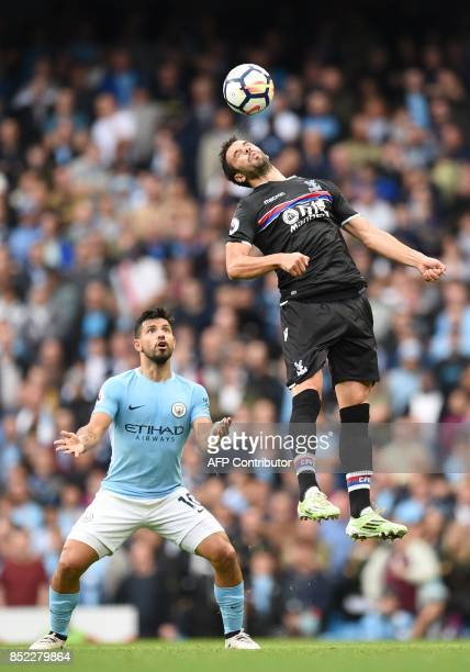 Crystal Palace's Serbian midfielder Luka Milivojevic heads the ball past Manchester City's Argentinian striker Sergio Aguero during the English...