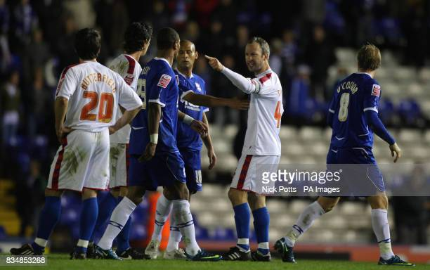 Crystal Palace's Shaun Derry points his finger as he is held away from teamate Jose Fonte after they conceded a last minute goal during the CocaCola...