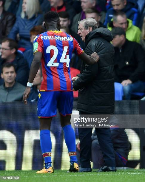 Crystal Palace's Timothy FosuMensah and Crystal Palace manager Roy Hodgson during the Premier League match at Selhurst Park London