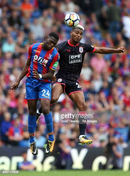 Crystal Palace's Timothy FosuMensah and Huddersfield Town's Steve Mounie battle for the ball during the Premier League match at Selhurst Park London