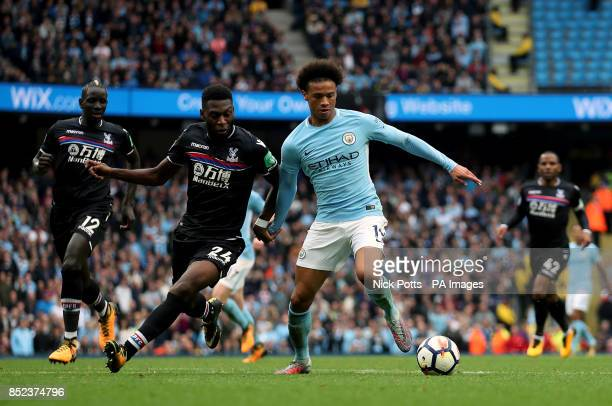 Crystal Palace's Timothy FosuMensah and Manchester City's Leroy Sane battle for the ball during the Premier League match at the Etihad Stadium...