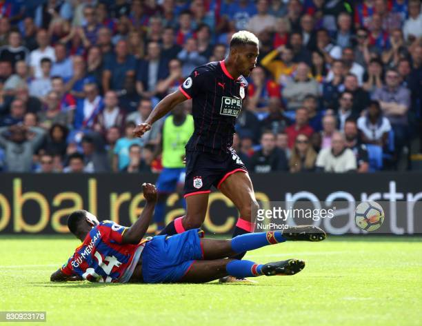 Crystal Palace's Timothy FosuMensah tackles Huddersfield Town's Steve Mounie during Premier League match between Crystal Palace and Huddersfield Town...