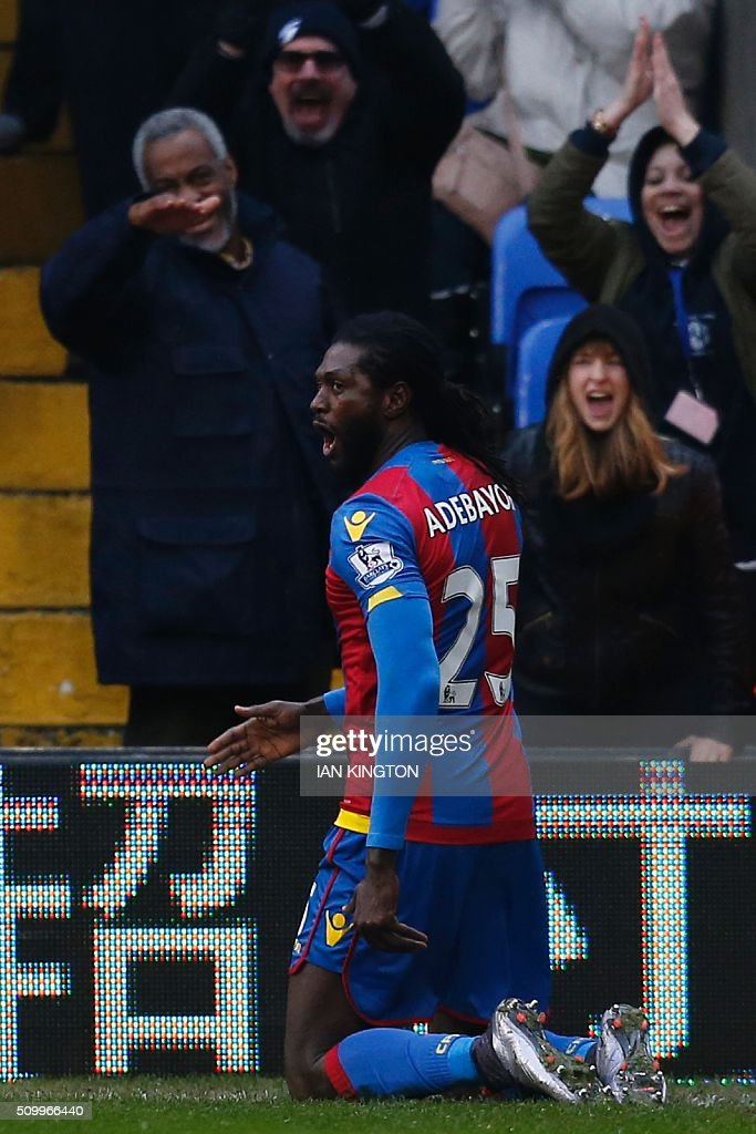 Crystal Palace's Togolese striker Emmanuel Adebayor celebrates scoring his team's first goal to equalise 1-1 during the English Premier League football match between Crystal Palace and Watford at Selhurst Park in south London on February 13, 2016. / AFP / Ian Kington / RESTRICTED TO EDITORIAL USE. No use with unauthorized audio, video, data, fixture lists, club/league logos or 'live' services. Online in-match use limited to 75 images, no video emulation. No use in betting, games or single club/league/player publications. /