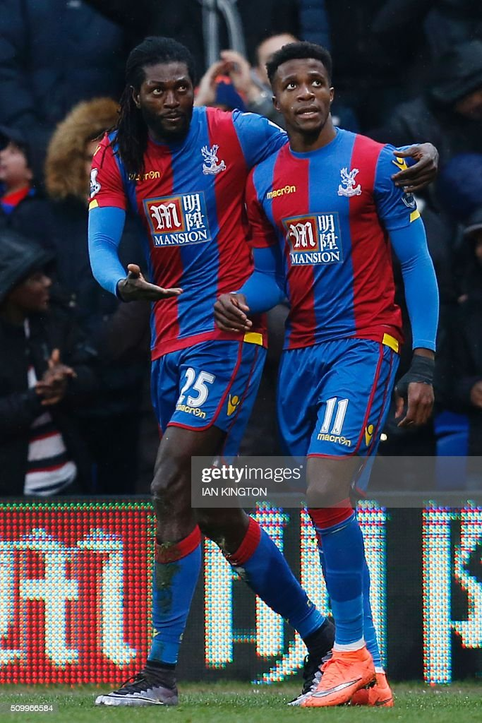 Crystal Palace's Togolese striker Emmanuel Adebayor (L) celebrates scoring his team's first goal to equalise 1-1 with Crystal Palace's Ivorian-born English striker Wilfried Zaha (R) during the English Premier League football match between Crystal Palace and Watford at Selhurst Park in south London on February 13, 2016. / AFP / Ian Kington / RESTRICTED TO EDITORIAL USE. No use with unauthorized audio, video, data, fixture lists, club/league logos or 'live' services. Online in-match use limited to 75 images, no video emulation. No use in betting, games or single club/league/player publications. /