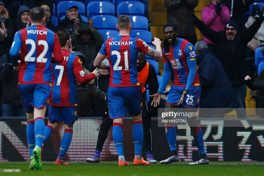 Crystal Palace's Togolese striker Emmanuel Adebayor (R) celebrates scoring his team's first goal to equalise 1-1 during the English Premier League football match between Crystal Palace and Watford at Selhurst Park in south London on February 13, 2016. / AFP / Ian Kington / RESTRICTED TO EDITORIAL USE. No use with unauthorized audio, video, data, fixture lists, club/league logos or 'live' services. Online in-match use limited to 75 images, no video emulation. No use in betting, games or single club/league/player publications. /