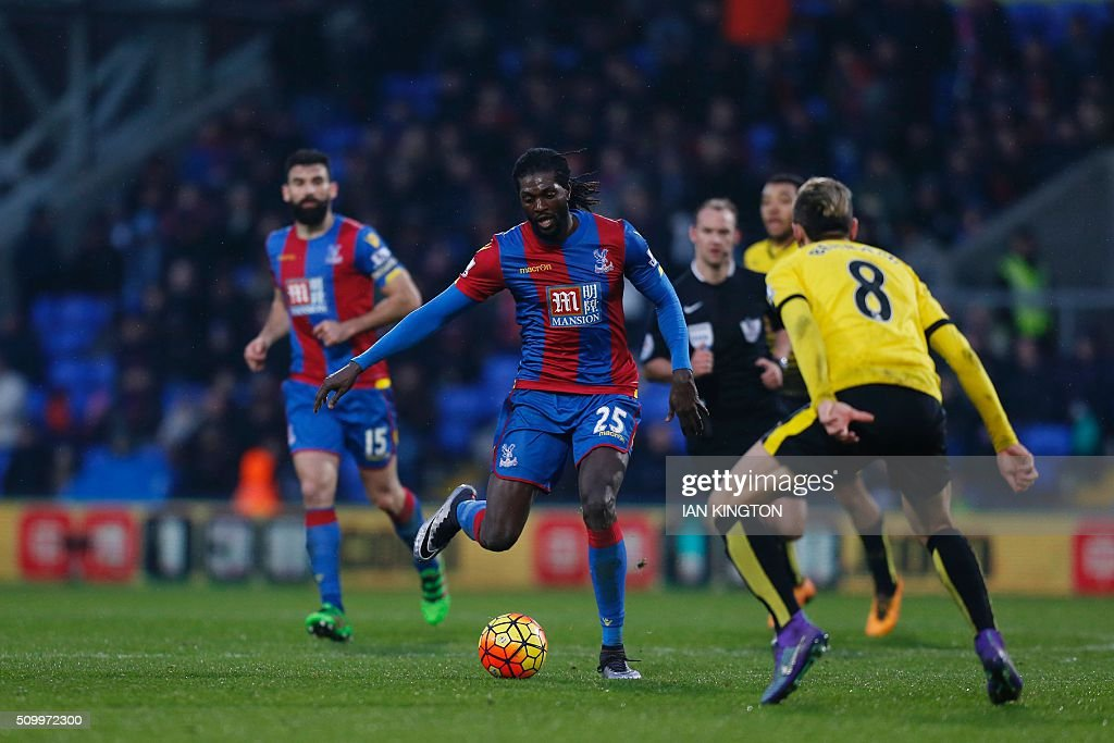 Crystal Palace's Togolese striker Emmanuel Adebayor (C) plays the ball during the English Premier League football match between Crystal Palace and Watford at Selhurst Park in south London on February 13, 2016. / AFP / Ian Kington / RESTRICTED TO EDITORIAL USE. No use with unauthorized audio, video, data, fixture lists, club/league logos or 'live' services. Online in-match use limited to 75 images, no video emulation. No use in betting, games or single club/league/player publications. /