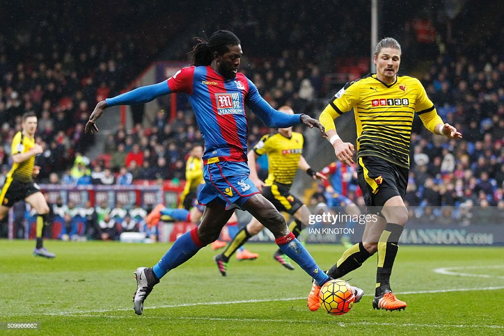 Crystal Palace's Togolese striker Emmanuel Adebayor (L) vies with Watford's Austrian defender Sebastian Prodl (R) during the English Premier League football match between Crystal Palace and Watford at Selhurst Park in south London on February 13, 2016. / AFP / Ian Kington / RESTRICTED TO EDITORIAL USE. No use with unauthorized audio, video, data, fixture lists, club/league logos or 'live' services. Online in-match use limited to 75 images, no video emulation. No use in betting, games or single club/league/player publications. /