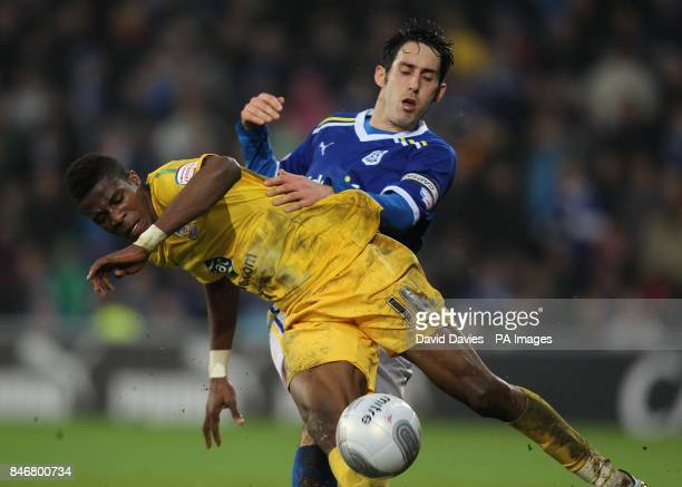 Crystal Palace's Wilfried Zaha and Cardiff City's Peter Whittingham battle for the ball