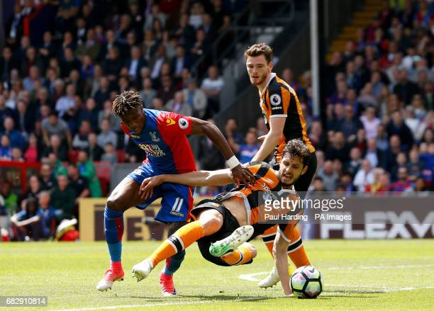 Crystal Palace's Wilfried Zaha and Hull City's Andrea Ranocchia battle for the ball during the Premier League match at Selhurst Park London