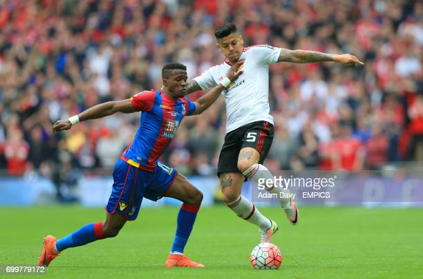 Crystal Palace's Wilfried Zaha and Manchester United's Marcos Rojo battle for the ball