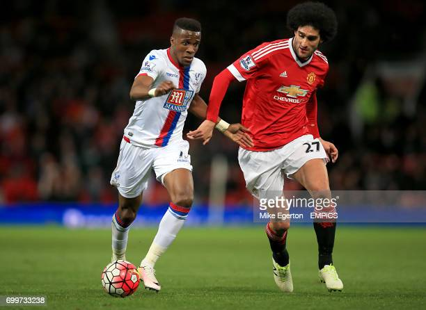 Crystal Palace's Wilfried Zaha and Manchester United's Marouane Fellaini battle for the ball