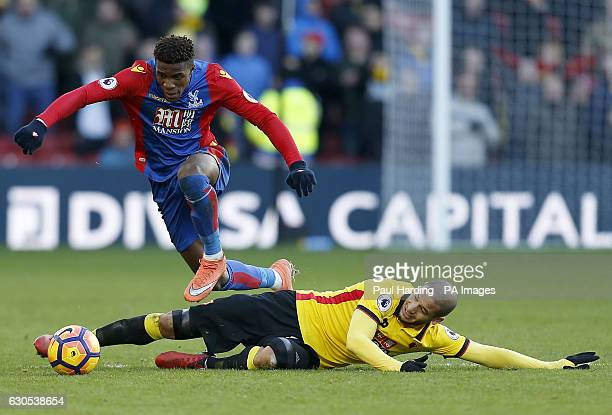Crystal Palace's Wilfried Zaha and Watford's Adlene Guedioura battle for the ball during the Premier League match at Vicarage Road Watford