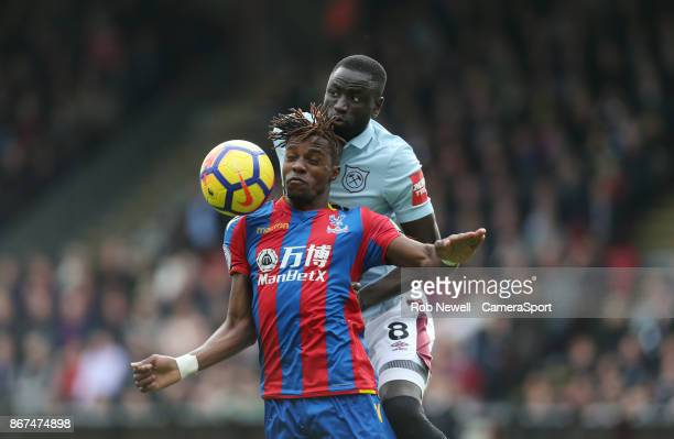 Crystal Palace's Wilfried Zaha and West Ham United's Cheikhou Kouyate during the Premier League match between Crystal Palace and West Ham United at...