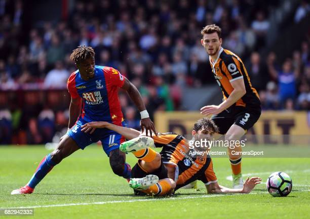 Crystal Palace's Wilfried Zaha battles for possession with Hull City's Andrea Ranocchia during the Premier League match between Crystal Palace and...