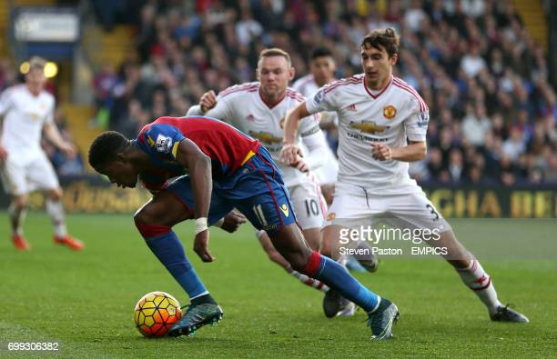 Crystal Palace's Wilfried Zaha battles for the ball with Manchester United's Matteo Darmian