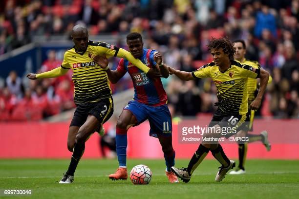 Crystal Palace's Wilfried Zaha battles for the ball with Watford's AllanRomeo Nyom and Watford's Nathan Ake