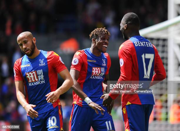 Crystal Palace's Wilfried Zaha congratulates Christian Benteke as he scores his sides second goal during the Premier League match against Hull City...