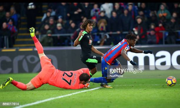 Crystal Palace's Wilfried Zaha gets brought down by Bournemouth's Asmir Begovic during Premier League match between Crystal Palace and AFC...