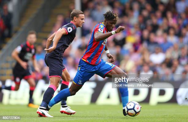 Crystal Palace's Wilfried Zaha in action with Huddersfield Town's Chris Lowe during the Premier League match at Selhurst Park London