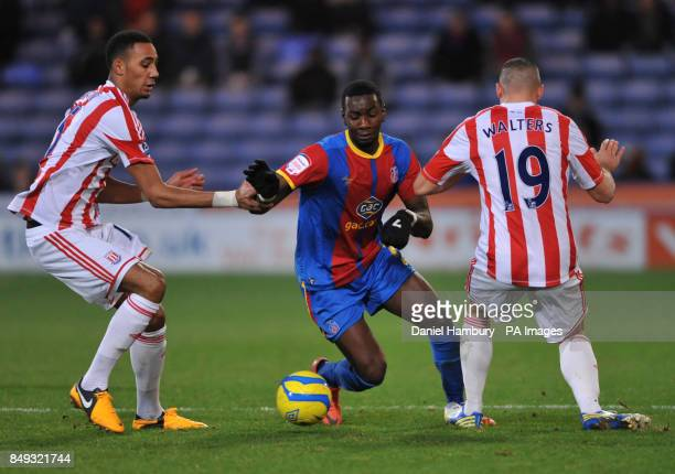Crystal Palace's Yannick Bolasie gets between Stoke's Steven N'Zonzi and Jonathan Walters during the FA Cup Third Round match at Selhurst Park London