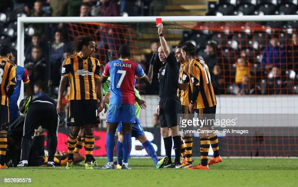 Crystal Palace's Yannick Bolasie is sent off by referee Anthony Taylor during the Barclays Premier League match at the KC Stadium Hull