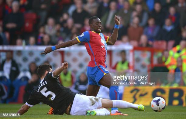 Crystal Palace's Yannick Bolasie is tackled by Southampton's Dejan Lovren during the Barclays Premier League match at Selhurst Park London