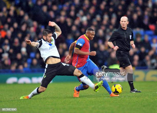 Crystal Palace's Yannick Bolasie Norwich City's Bradley Johnson square up challenge for ball during the Barclays Premier League match at Selhurst...