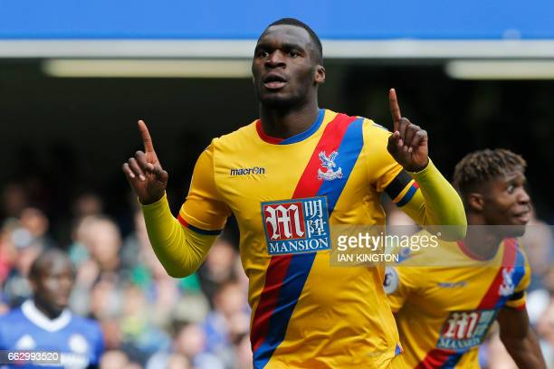 Crystal Palace's Zaireborn Belgian striker Christian Benteke celebrates after scoring their second goal during the English Premier League football...