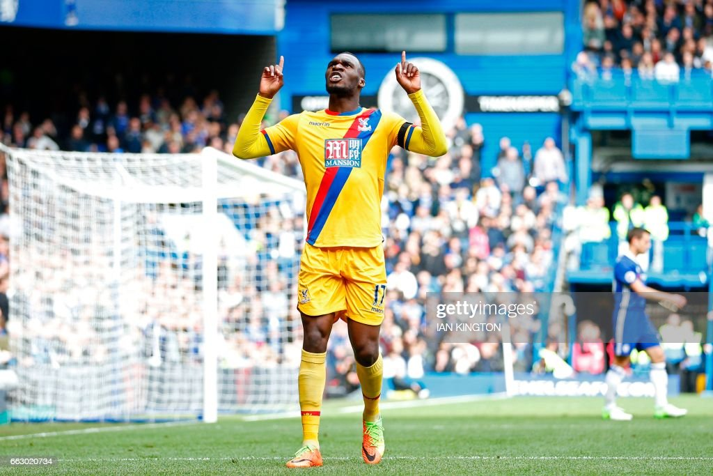 Crystal Palace's Zaire-born Belgian striker Christian Benteke celebrates after scoring their second goal during the English Premier League football match between Chelsea and Crystal Palace at Stamford Bridge in London on April 1, 2017. / AFP PHOTO / Ian KINGTON / RESTRICTED TO EDITORIAL USE. No use with unauthorized audio, video, data, fixture lists, club/league logos or 'live' services. Online in-match use limited to 75 images, no video emulation. No use in betting, games or single club/league/player publications. /