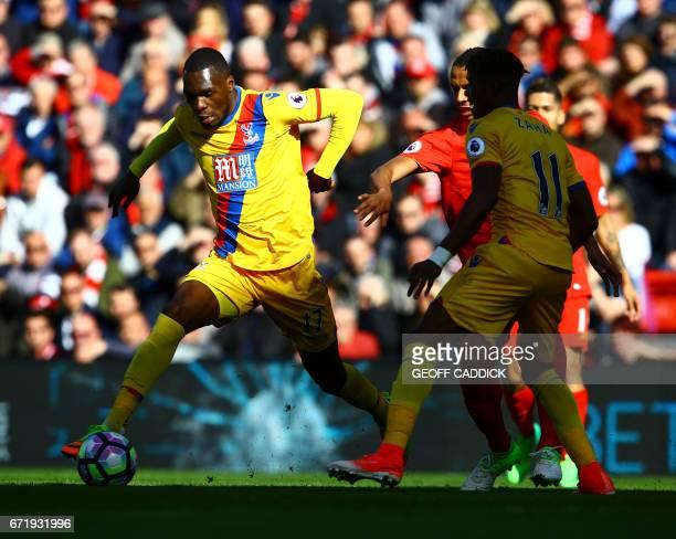 Crystal Palace's Zaireborn Belgian striker Christian Benteke controls the ball during the English Premier League football match between Liverpool and...
