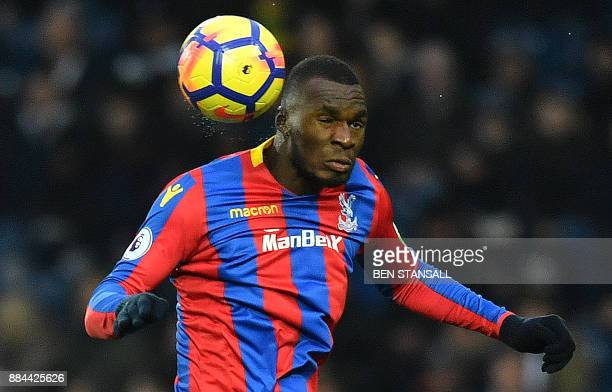 Crystal Palace's Zaireborn Belgian striker Christian Benteke headers the ball during the English Premier League football match between West Bromwich...