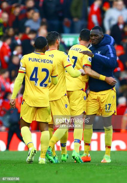 Crystal Palace's Zaireborn Belgian striker Christian Benteke is congratulated for scoring two goals by teammates after the final whistle of the...