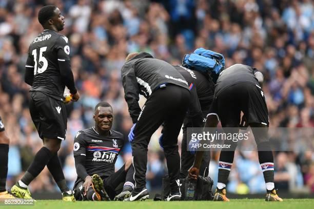 Crystal Palace's Zaireborn Belgian striker Christian Benteke picks up an injury during the English Premier League football match between Manchester...
