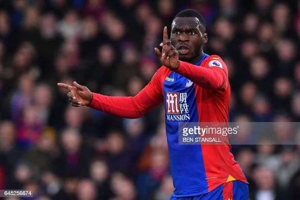 Crystal Palace's Zaireborn Belgian striker Christian Benteke reacts after being called offside by the linesman during the English Premier League...
