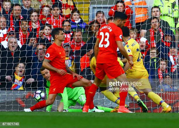 Crystal Palace's Zaireborn Belgian striker Christian Benteke scores past Liverpool's Belgian goalkeeper Simon Mignolet during the English Premier...
