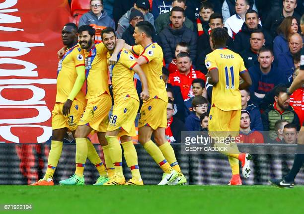 Crystal Palace's Zaireborn Belgian striker Christian Benteke celebrates scoring a goal with Crystal Palace's English defender James Tomkins and...