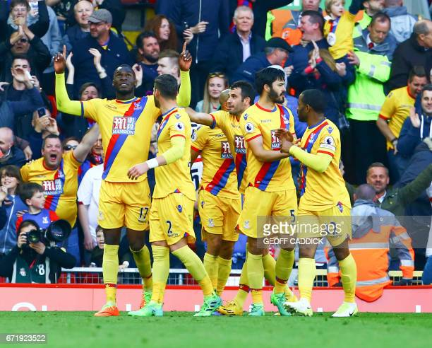 Crystal Palace's Zaireborn Belgian striker Christian Benteke celebrates scoring a goal with Crystal Palace's English defender Joel Ward Crystal...