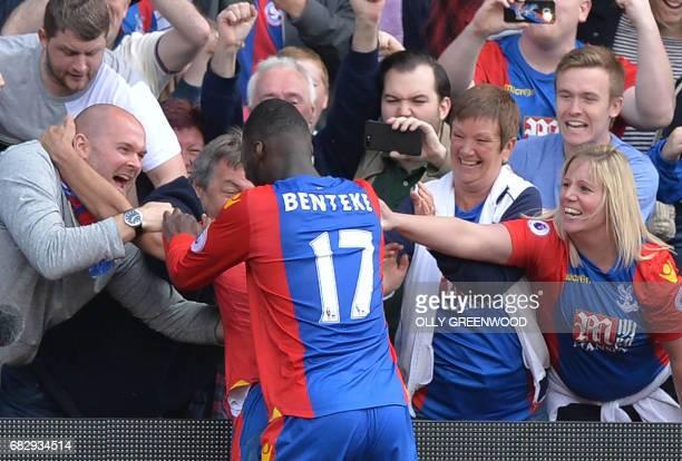 Crystal Palace's Zaireborn Belgian striker Christian Benteke celebrates scoring the second goal during the English Premier League football match...