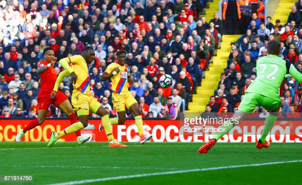 Crystal Palace's Zaireborn Belgian striker Christian Benteke shoots and scores past Liverpool's Belgian goalkeeper Simon Mignolet during the English...