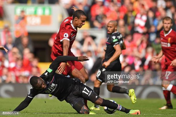 Crystal Palace's Zaireborn Belgian striker Christian Benteke vies with Liverpool's Germanborn Cameroonian defender Joel Matip during the English...