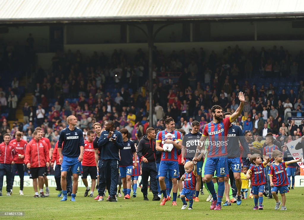 Crystal Palance players salute the fans after the Barclays Premier League match between Crystal Palace and Swansea City at Selhurst Park on May 24, 2015 in London, England.