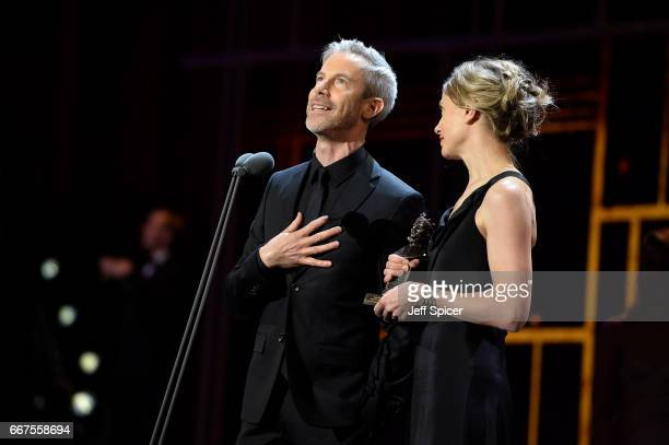 Crystal Pite and Jonathon Young win the award for Best New Dance Production for 'Betroffenheit' on stage during The Olivier Awards 2017 at Royal...